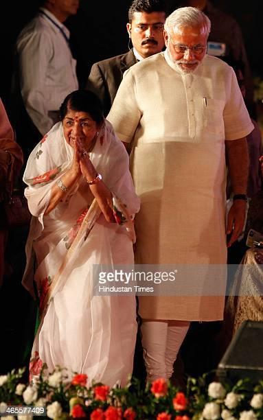 BJPs prime ministerial candidate Narendra Modi felicitates legendary singer Lata Mangeshkar during 'Sherahta Bharat' Aye Mere Watan Ke Logon for...