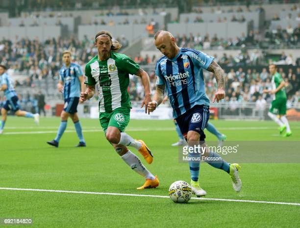 Bjørn Paulsen of Hammarby IF and Magnus Eriksson of Djurgardens IF competes for the ball during the Allsvenskan match between Hammarby IF and...
