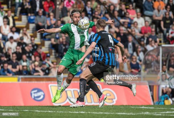 Bjørn Paulsen of Hammarby IF and Oscar Pehrsson of IK Sirius FK during the Allsvenskan match between IK Sirius FK and Hammarby IF at Studenternas IP...