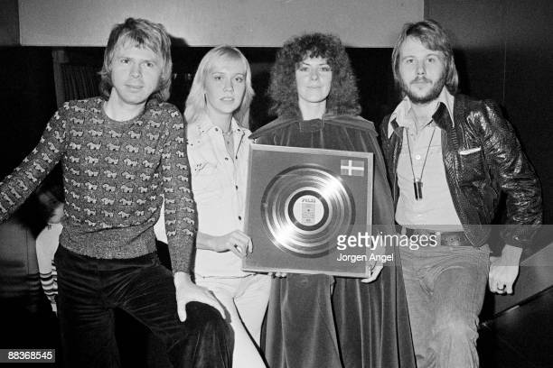 Björn Ulvaeus Agnetha Fältskog AnniFrid Lyngstad and Benny Andersson of the pop group Abba holding a silver disc for sales of their second album...