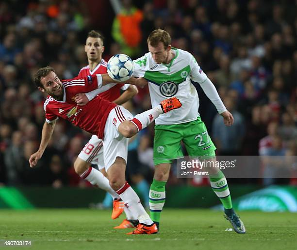 BJuan Mata of Manchester United in action with Maximilian Arnold during the UEFA Champions League Group C match between Manchester United and...