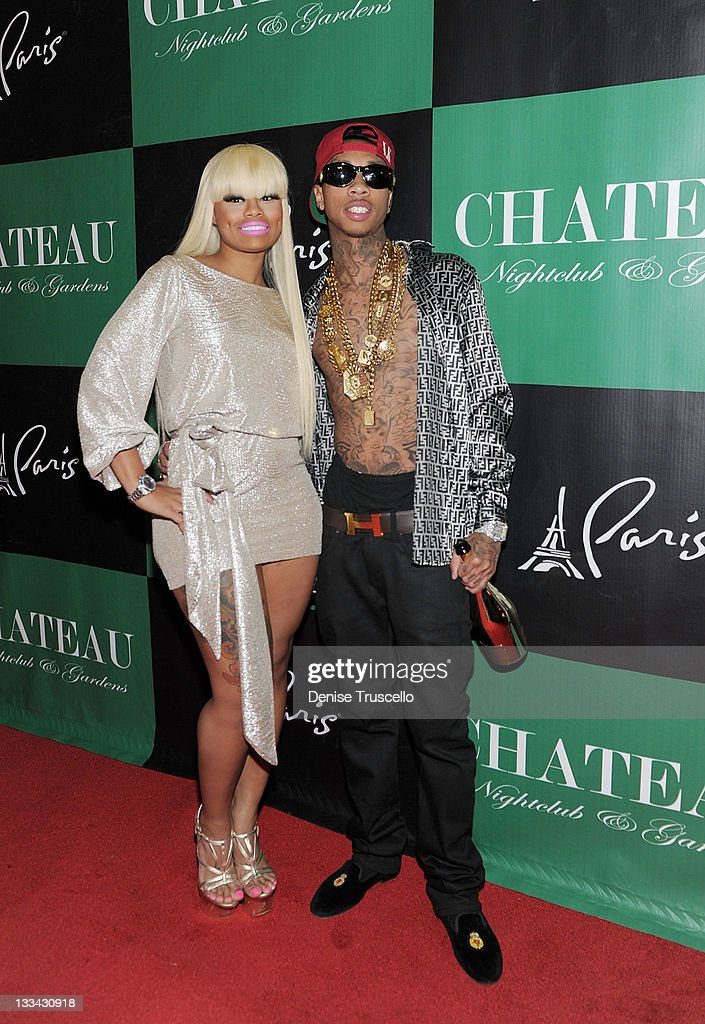 Blac Chyna and Tyga arrive at Tyga's 22nd birthday party at Chateau Nightclub Gardens on November 18 2011 in Las Vegas Nevada