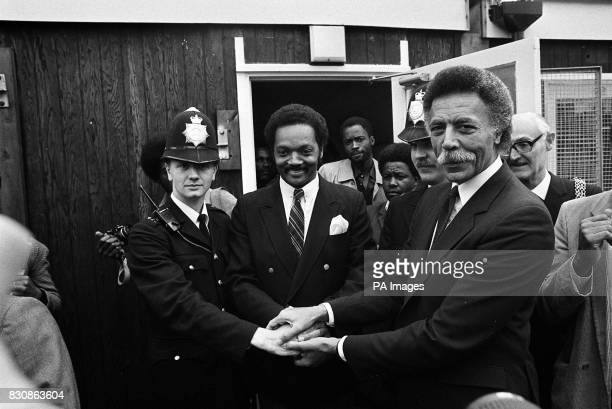 Black American civil rights leader and a contender for the Democratic presidential nomination the Rev Jesse Jackson with PC Gary Trapp and US...