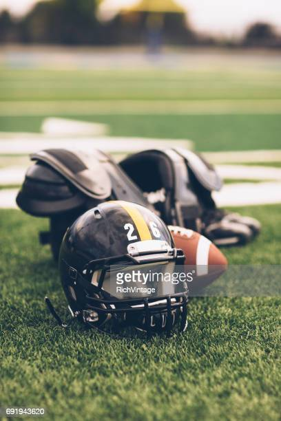 Black American Football Helmet on Playing Field