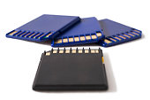 Beautiful macro photo of black and blue memory cards on white background