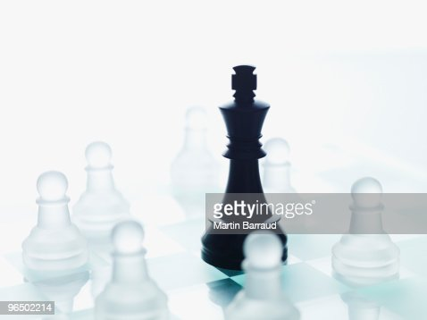 Black and glass chess pieces : Stock Photo