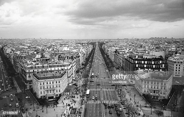 black and white aerial view of a city street and buildings