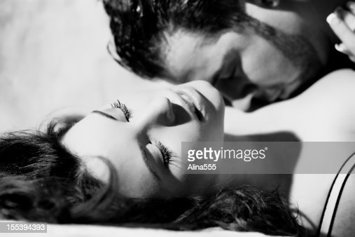 Black and white boudoir portrait of a couple