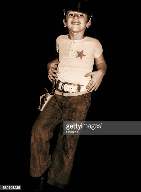 Black and white boy disguised as a sheriff