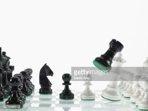 Black and white chess teams with taken rook