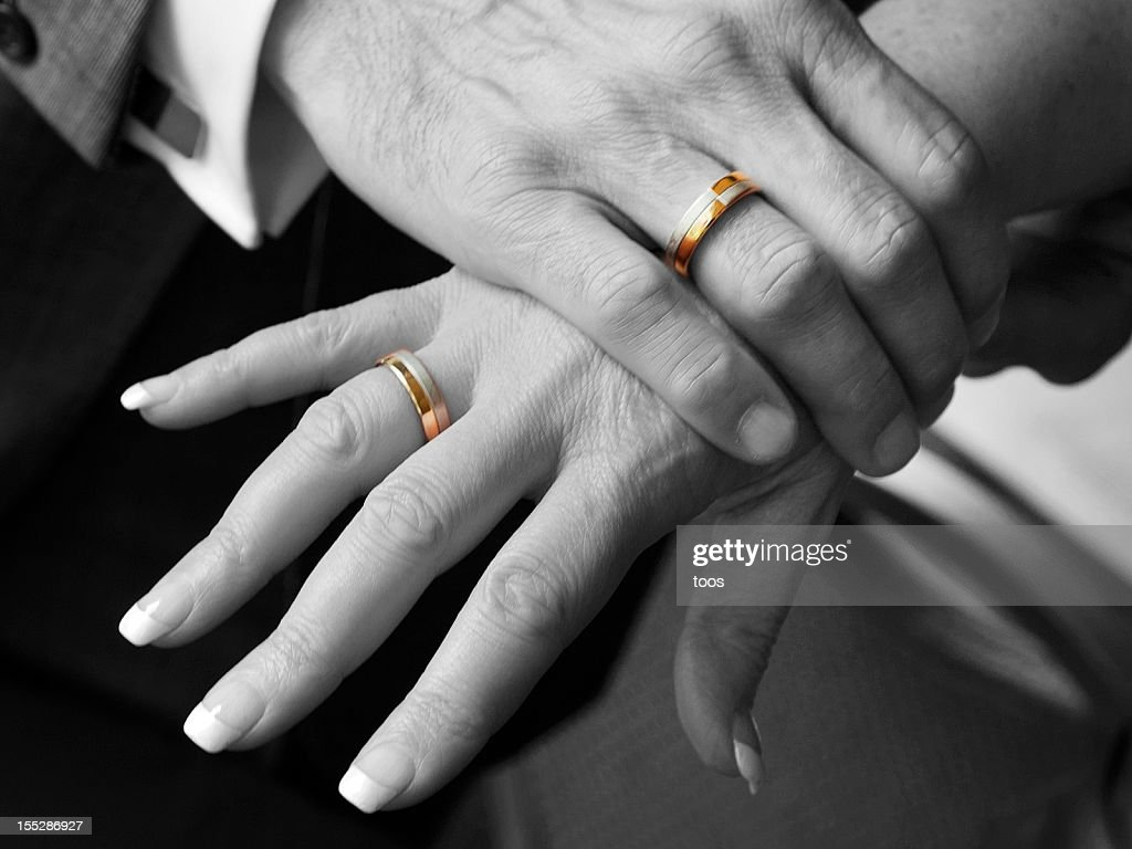 hand wedding ring. black and white, close-up - hands with golden wedding rings hand ring