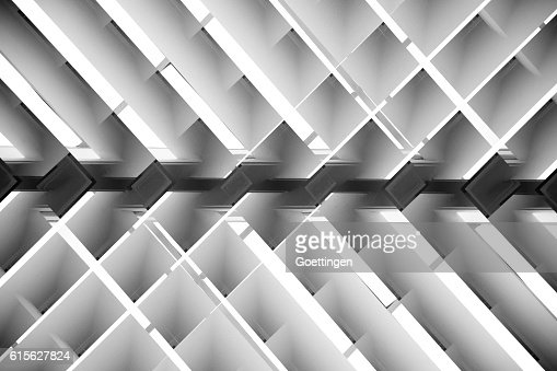Black and white close-up photo of brightly lit lath ceiling : Stock-Foto