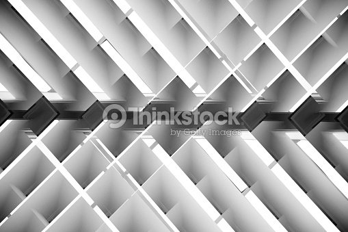 Black and white close-up photo of brightly lit lath ceiling : Photo