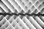 Brightly lit lath ceiling / roof. Abstract background photo on the subject of hi-tech architecture and interior.