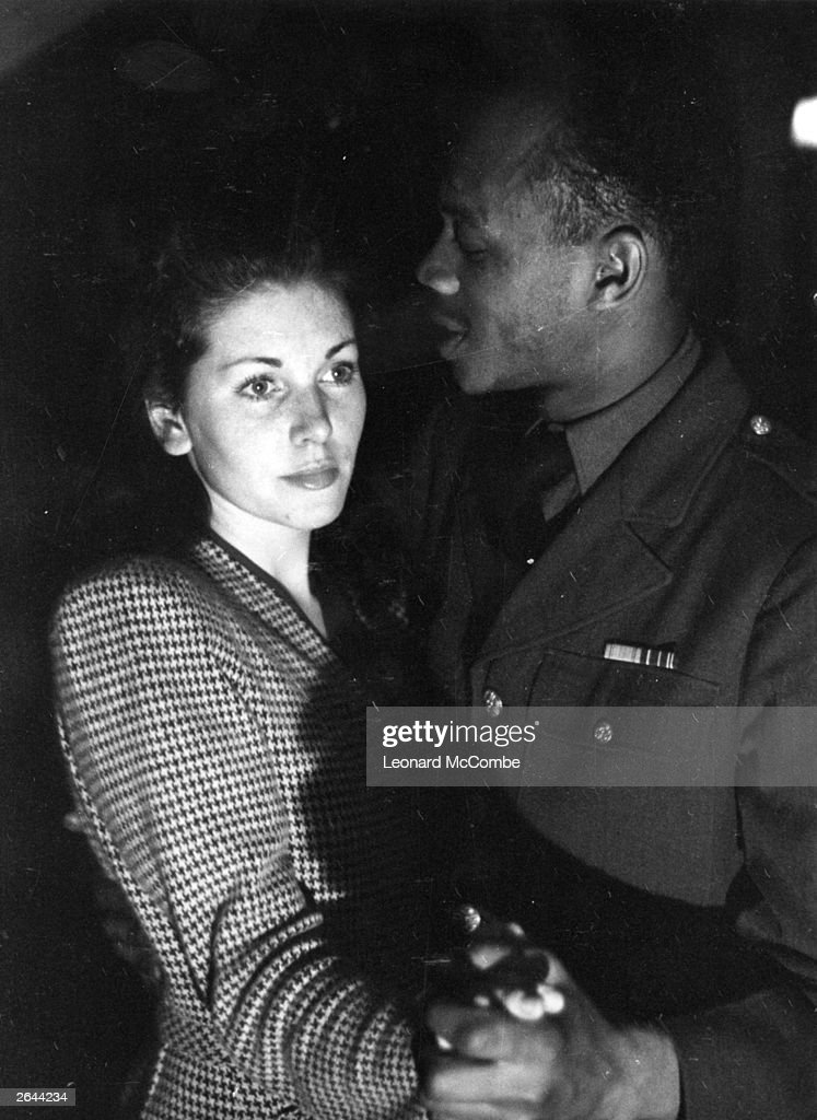 A black and white couple dancing at Frisco's International Club, Piccadilly, London. Original Publication: Picture Post - 1486 - Inside London's Coloured Clubs - pub. 1943