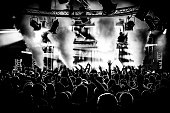 Black and white DJ crowd in nightclub party with ice canon and smoke machine
