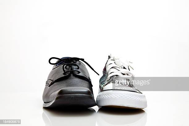 Black and white dress shoe and sneaker