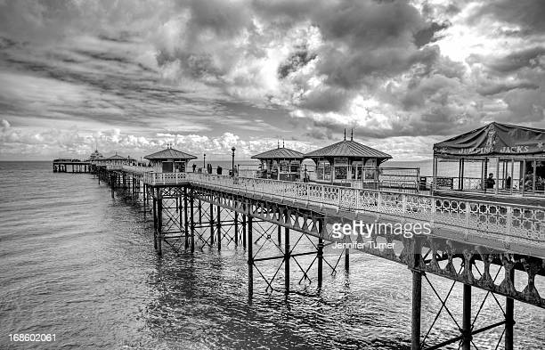CONTENT] Black and white image of Llandudno Pier in Conwy North Wales Stretching out to sea
