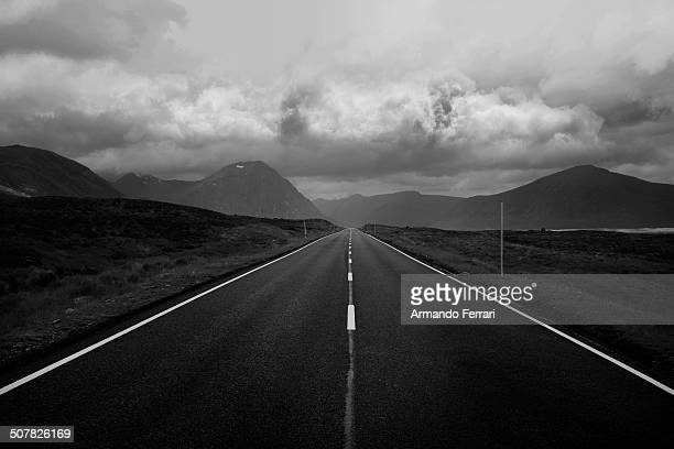 Black and white image of straight road and mountains, Scottish Highlands, Scotland