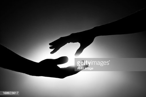 Black and white image of two hands reaching out