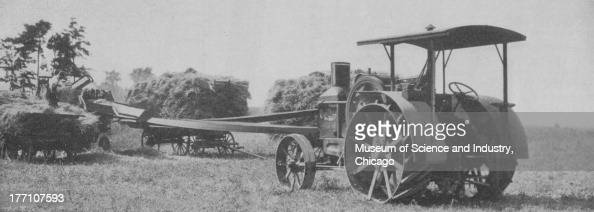 Black White An D Tractor Pulling Wagon : Rumely oil pull stock photos and pictures getty images
