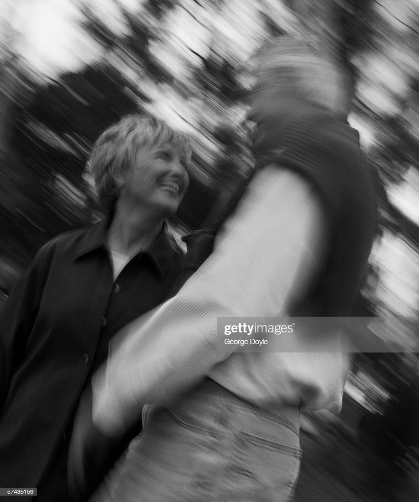 black and white low angle view of a mature couple talking outdoors : Stock Photo