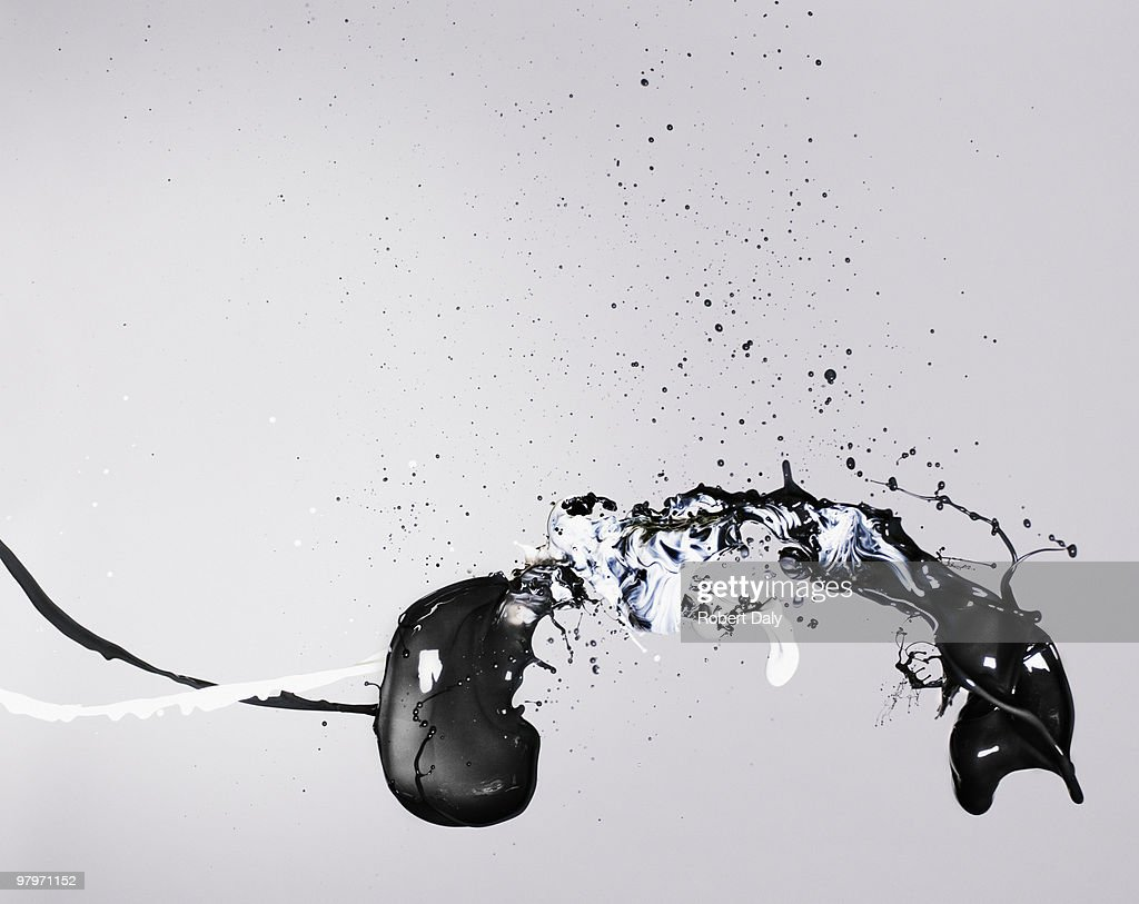 Black and white paint colliding : Stock Photo