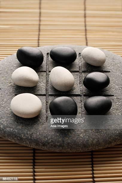 black and white pebbles on zen stone