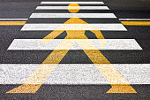 Black and white pedestrian crossing with silhouette of man on it