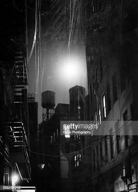 Black and white photo of a dark alley at nigth, NY