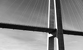 Black and white photo of modern automotive cable-stayed bridge in Norway