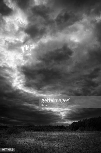 Black and white photo of clouds parting to create a path