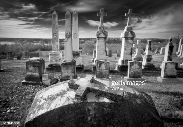 Black and white photo of tombstones in a cemetery at St Ignatius Church Port Tobacco Maryland