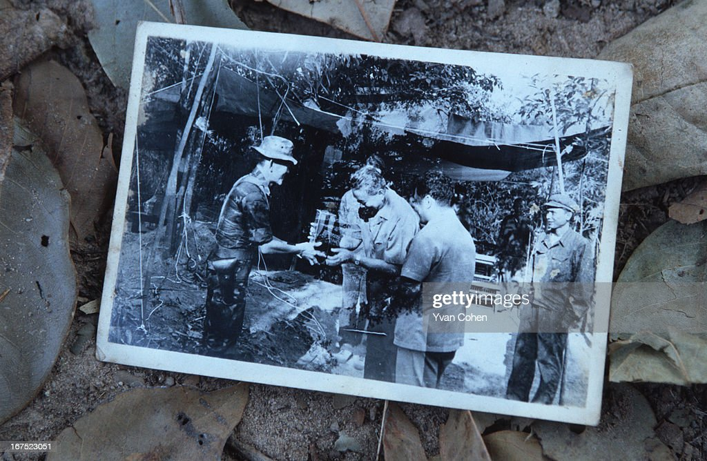 A black and white photograph showing Khmer Rouge leader Pol Pot meeting with Thai troops in Cambodia. .