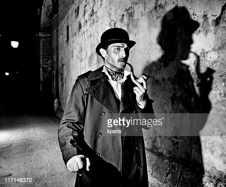 Black and white picture of a detective smoking his pipe