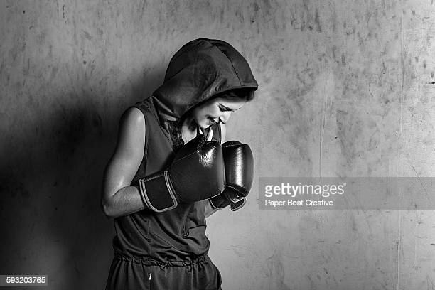 Black and white portrait of a young lady boxing
