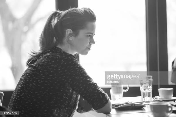 Black And White Portrait Of Pretty Girl In Coffee Shop