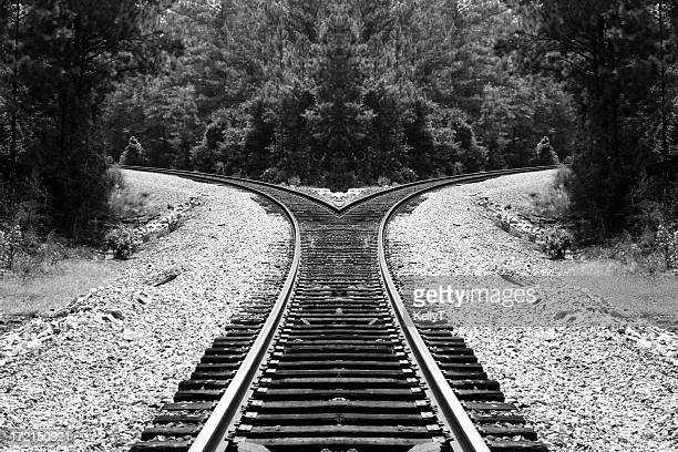 Black and white railroad trick splitting in two directions