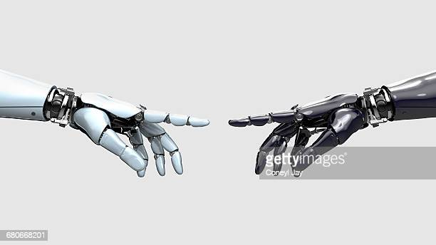 Black and white robot hand pointing at each other