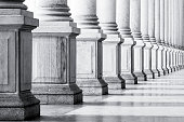 Closeup black and white row of classical marble columns. Symbols of integrity, stability, and trustworthiness.  Detail of Mlynska colonnade Karlovy Vary Czech republic establish 1881, this is the bigg