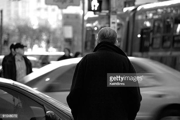 Black and white shot of a man on the street