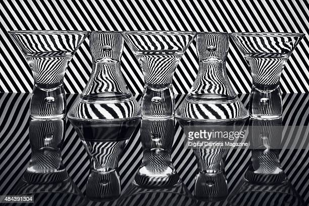 A black and white stripe pattern refracted through a row of waterfilled glasses taken on October 16 2014
