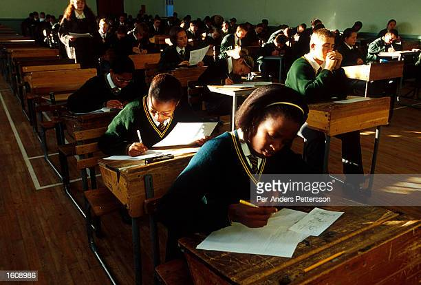 Black and white students take a test June 21 2001 at Vryburg High School in Vryburg South Africa Vryburg a small and very conservative farming town...