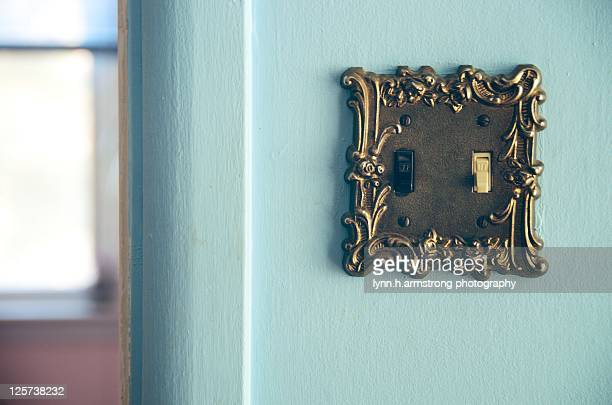 Black and  white switches in lightswitch on wall