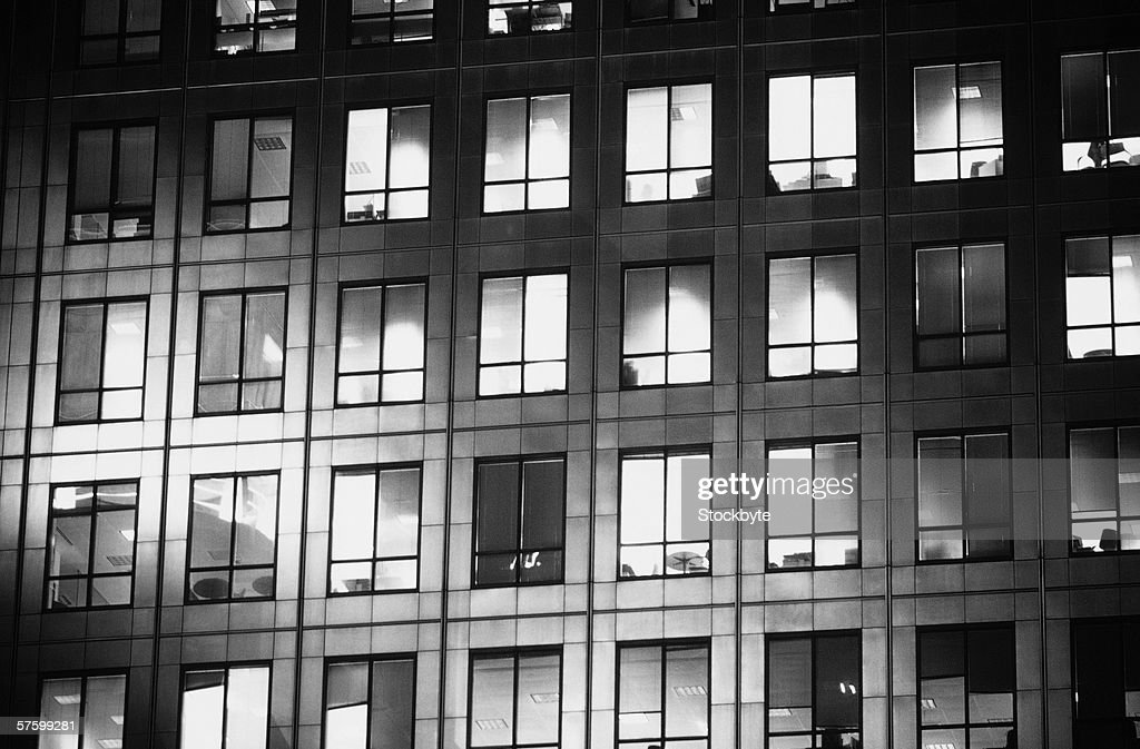 black and white view of windows of an office building : Stock Photo