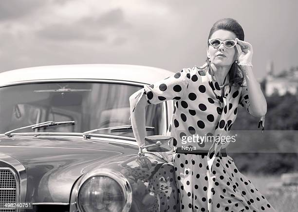 Black and White Vintage Woman Portret at an Old Car
