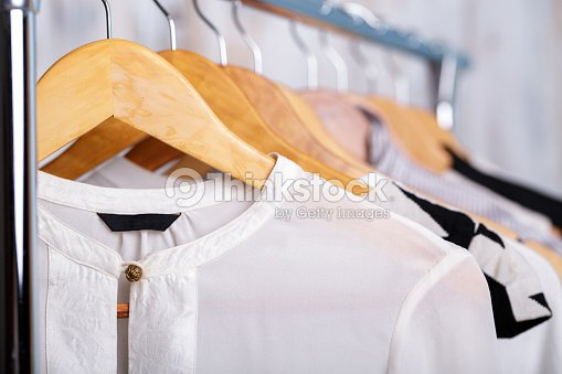 20fa83a6b76 black and white womens clothes on hangers on rack in fashion sto   Stock  Photo