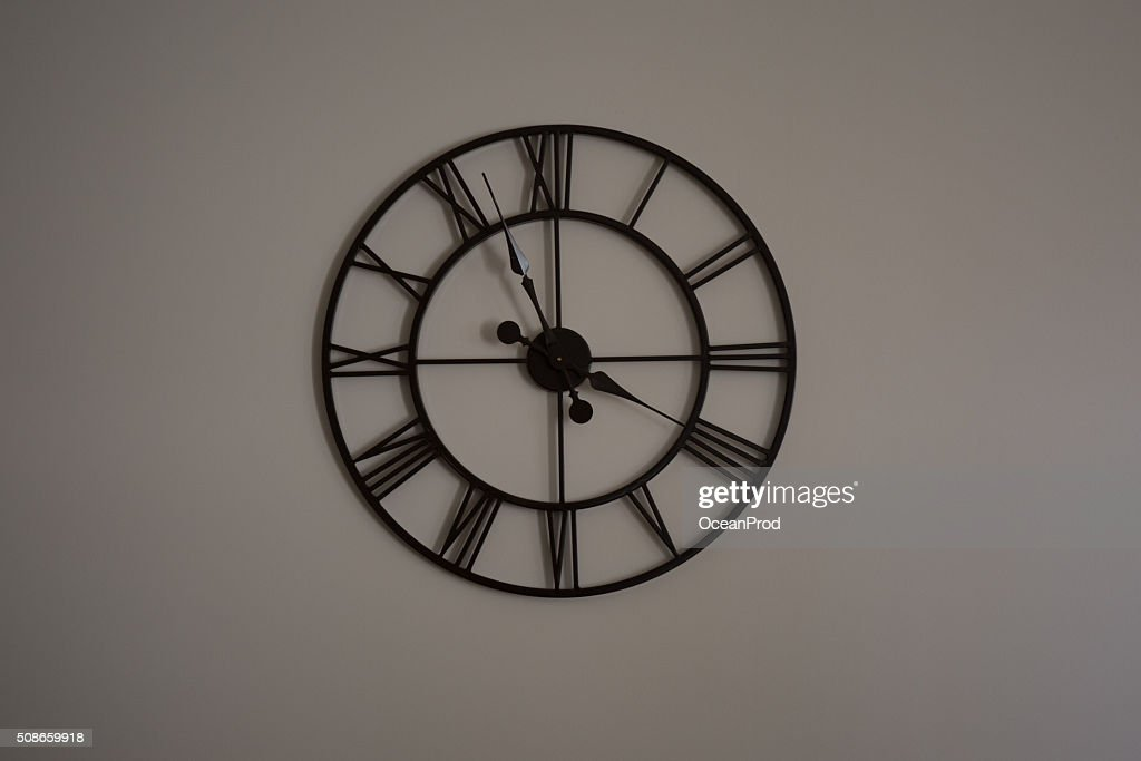 Black Antique clock on the wall isolated : Stock Photo