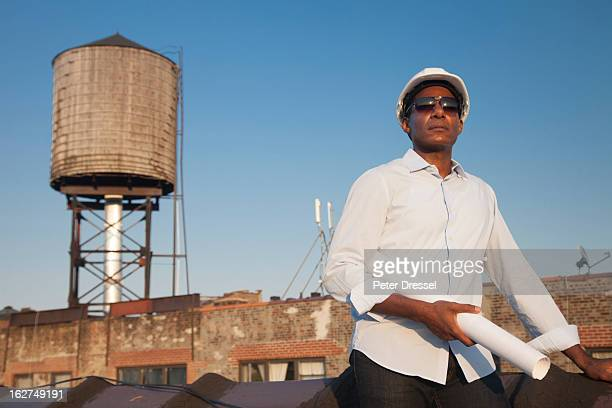 Black architect standing on rooftop