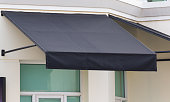 black awning and steel structure over window frame, outdoor house decoration